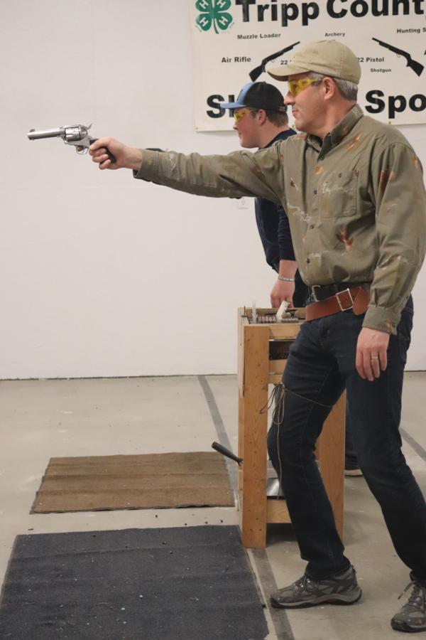 Chapter members Mark Studt and Luke Murphy facing off in the quick draw challenge in Winner, South Dakota.