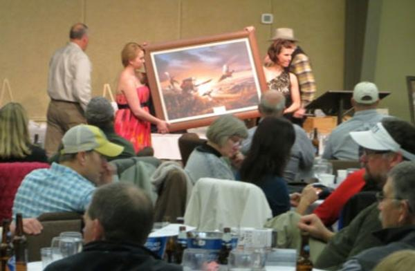 A PF print is sold at the 2013 PF Banquet in Helena
