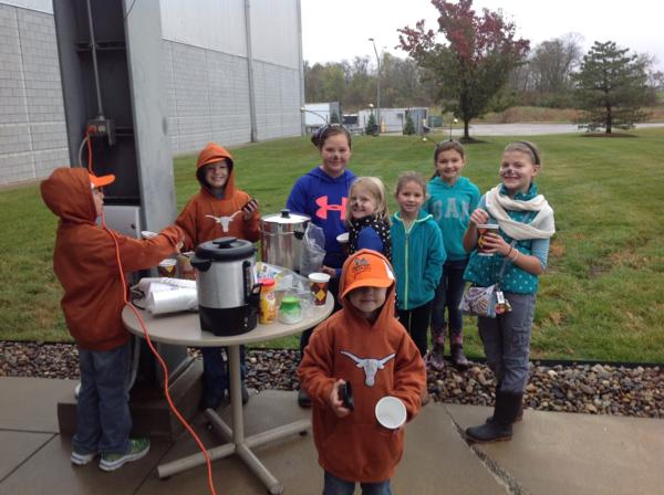 Kids enjoyed food and help plant the plot.