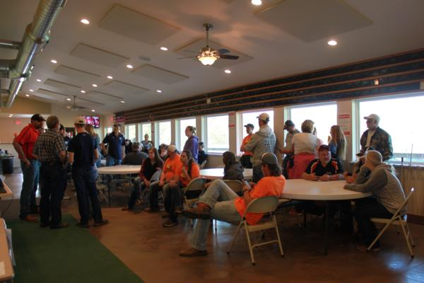 KIM & DOUG WYMAN PRESENTING AWARDS AT the 2017 October Corridor Clay Crushers tournament - 2nd Annual Pheasants Forever shootout hosting 9 collegiate trap teams at Otter Creek in Cedar Rapids Iowa