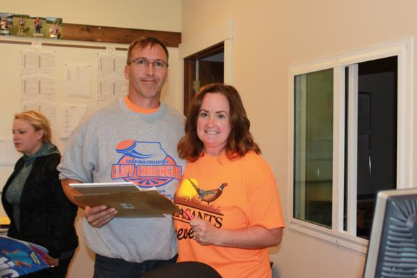 Shoot managers Brad and Tina Elwood Gehrke at the 2017 October Corridor Clay Crushers tournament - 2nd Annual Pheasants Forever shootout hosting 9 collegiate trap teams at Otter Creek in Cedar Rapids Iowa