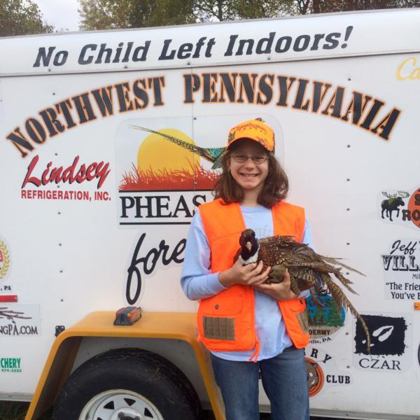 Lindsey's first rooster!