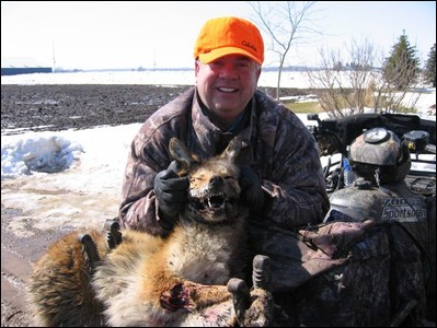 Grinning Dave Peck and coyote.