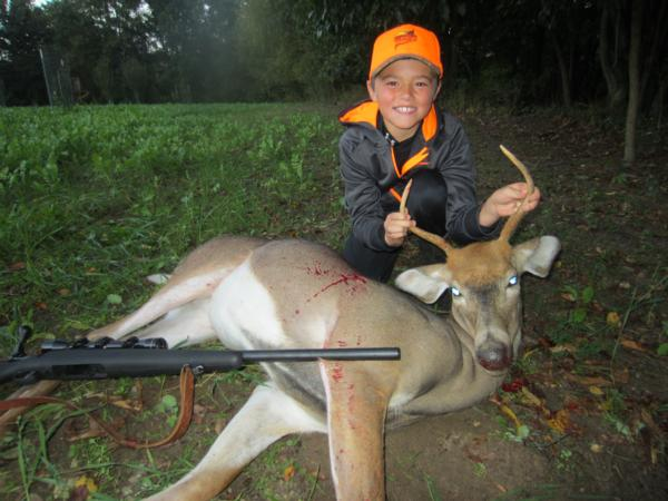 Cameron and his first gun kill deer